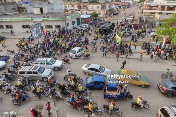 Benin security forces are seen at a busy intersection during an evacuation in downtown Cotonou on January 27 2017 On the streets of Benin's economic...