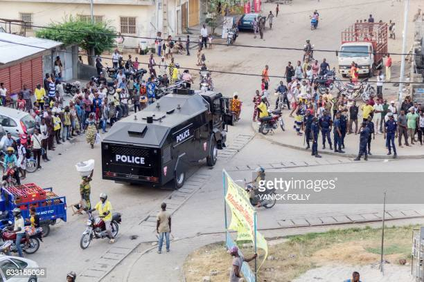 Benin security forces stand at a busy intersection during an evacuation in downtown Cotonou on January 27 2017 On the streets of Benin's economic...