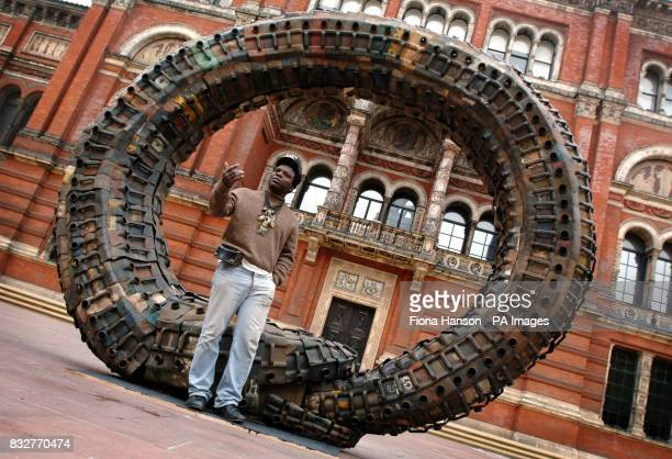 Beninese sculptor Romuald Hazoume with his work which forms part of the 'Uncomfortable Truths the shadow of slave trading on contemporary art and...