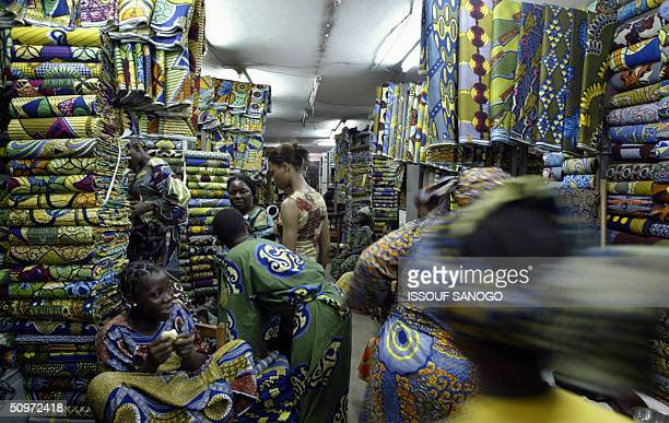 Beninese women crowd a cloth store in the Cotonou market 17 June 2004 Beninese deputies voted 17 June 2004 a new family code banning polygamy and the...