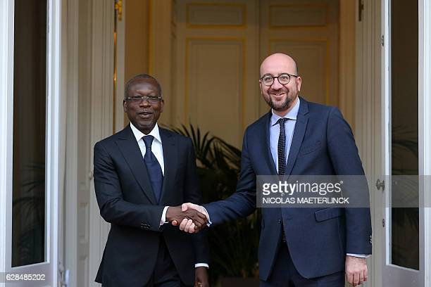Benin's President Patrice Talon and Belgian Prime Minister Charles Michel shake hands within their meeting on December 87 2016 in Brussels / AFP /...