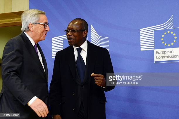 Benin's President Patrice Talon and European Union Commission President JeanClaude Juncker arrive to pose for photographs prior to their meeting at...