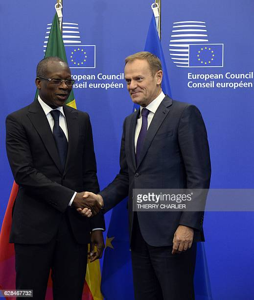 Benin's President Patrice Talon shakes hands with European Union Council President Donald Tusk before their meeting a the European Union Council...