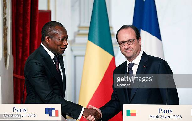 Benin's President Patrice Talon shakes hands with French President Francois Hollande after a joint press conference at the Elysee Presidential Palace...