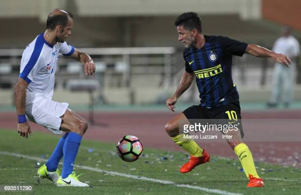 Benito Carbone of Inter Forever competes for the ball with Aggelos Barinas of Greece 2004 during the friendlt match between Greece 2004 and Inter...