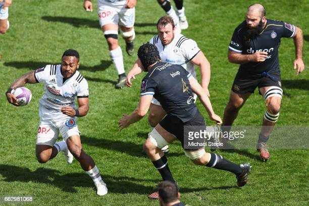 Benito Masilevu of Brive sidesteps Charlie Ewels of Bath during the European Rugby Challenge Cup Quarter Final match between Bath Rugby and Brive at...