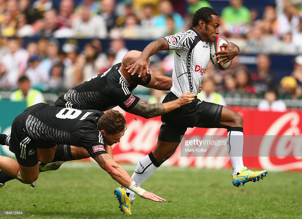 Benito Masilevu of Fiji is tackled during the cup semi final match between New Zealand and Fiji during day three of the 2013 Hong Kong Sevens at Hong Kong Stadium on March 24, 2013 in So Kon Po, Hong Kong.
