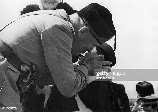Benito Mussolini *29071883 Politician Italy 19251943/45 dictator of Italy bestowing gold medals of bravery to the bereaved of pilots who fell in the...