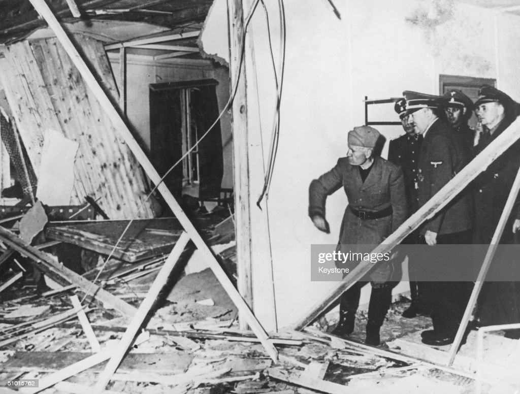 Benito Mussolini (1883 - 1845) and Adolf Hitler (1889 - 1945) inspect the wreckage of the conference room in Hitler's headquarters following a failed bombing assassination attempt of the Nazi leader, Rastenburg, East Prussia, Germany, July 1944.