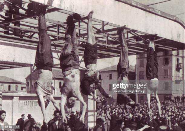 Benito Mussolini and his mistress Clara Petacci hanging in a public square after their execution by Italian Communist partisans in April 1945