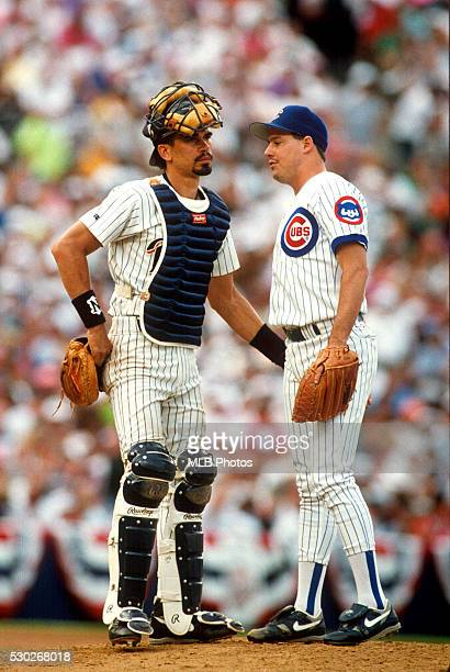 Benito Santiago of the San Diego Padres and Greg Maddux of the Chicago Cubs meet on the mound during the 63rd Major League Baseball AllStar Game at...