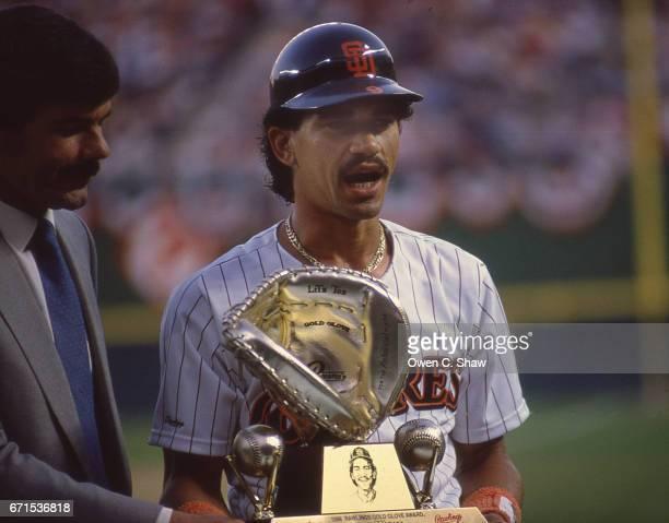 Benito Santiago of the San Diego Padres circa 1988 receives his gold glove award at Jack Murphy Stadium in San Diego California