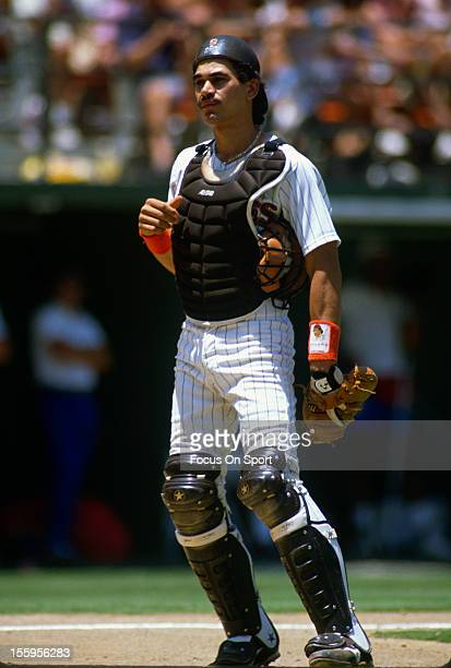 Benito Santiago of the San Diego Padres looks on during an Major League Baseball game circa 1989 at Jack Murphy Stadium in San Diego California...
