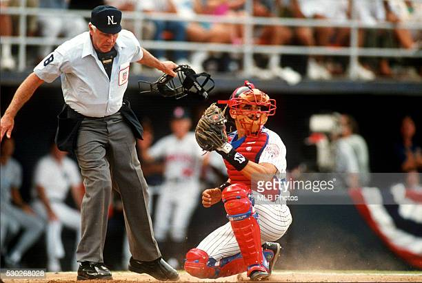 Benito Santiago of the San Diego Padres picks the ball out of the dirt during the 63rd Major League Baseball AllStar Game at Jack Murphy Stadium on...