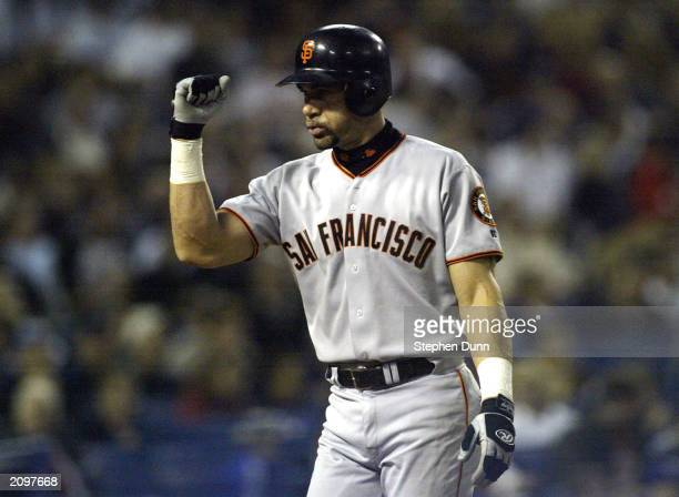 Benito Santiago of the San Francisco Giants celebrates after hitting a home run against the Los Angeles Dodgers on June 19 2003 at Dodger Stadium in...