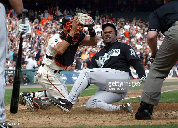 Benito Santiago the San Francisco Giants tags out Lenny Harris of the Florida Marlins during the NLDS Game 2 at Pac Bell Park in San Francisco Ca