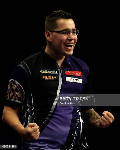 Benito van de Pas of the Netherlands celebrates winning his first round match against Paul Nicholson of England on day four of the 2015 William Hill...