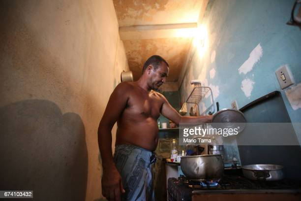 Benivaldo Vicente cooks in his home in the Gamboa de Baixo community on April 19 2015 in Salvador Brazil