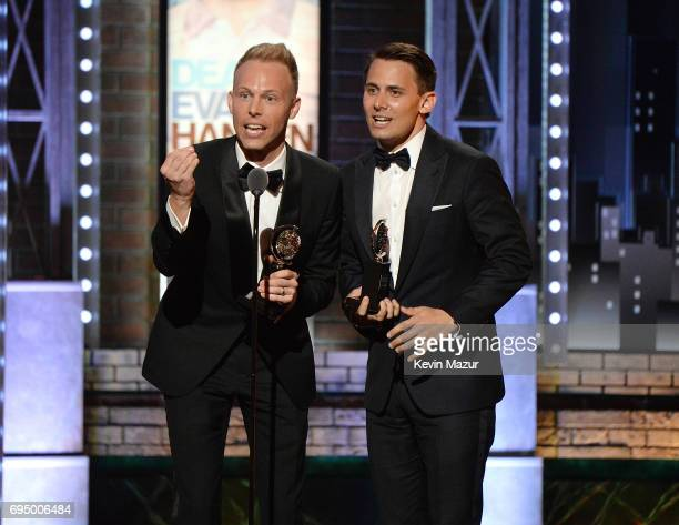 Benj Pasek and Justin Paul accept award onstage during the 2017 Tony Awards at Radio City Music Hall on June 11 2017 in New York City