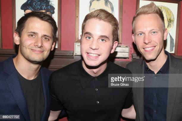Benj Pasek Ben Platt and Justin Paul pose as Ben Platt gets honored for his performance in his broadway show 'Dear Evan Hansen' wth a caricature on...