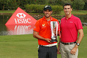 Benjamin Alvarado of Chile and Sebastian Arcuri of HSBC Brazil pose with the trophy after Alvarado's victory at the Brasil Classic Presented by HSBC...