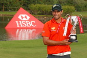 Benjamin Alvarado of Chile poses with the trophy after his onestroke victory at the Brasil Classic Presented by HSBC at the Sao Paulo Golf Club on...