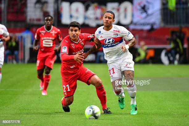 Benjamin Andre of Rennes and Memphis Depay of Lyon during the Ligue 1 match between Stade Rennais and Olympique Lyonnais at Roazhon Park on August 11...