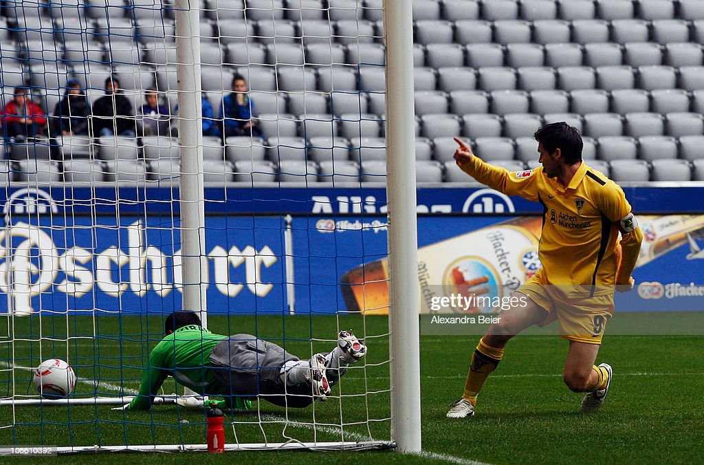 <a gi-track='captionPersonalityLinkClicked' href=/galleries/search?phrase=Benjamin+Auer&family=editorial&specificpeople=535659 ng-click='$event.stopPropagation()'>Benjamin Auer</a> (R) of Aachen scores a goal against goalkeeper Gabor Kiraly of Muenchen during the Second Bundesliga match between 1860 Muenchen and Alemannia Aachen at Allianz Arena on November 7, 2010 in Munich, Germany.