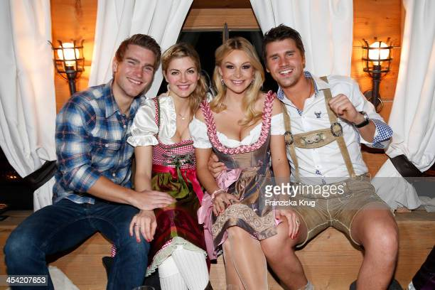 Benjamin Baarz Nina Bott Jana Julie Kilka and Thore Schoelermann attend the Dorfstadl Evening Tirol Cross Mountain 2013 on December 07 2013 in...