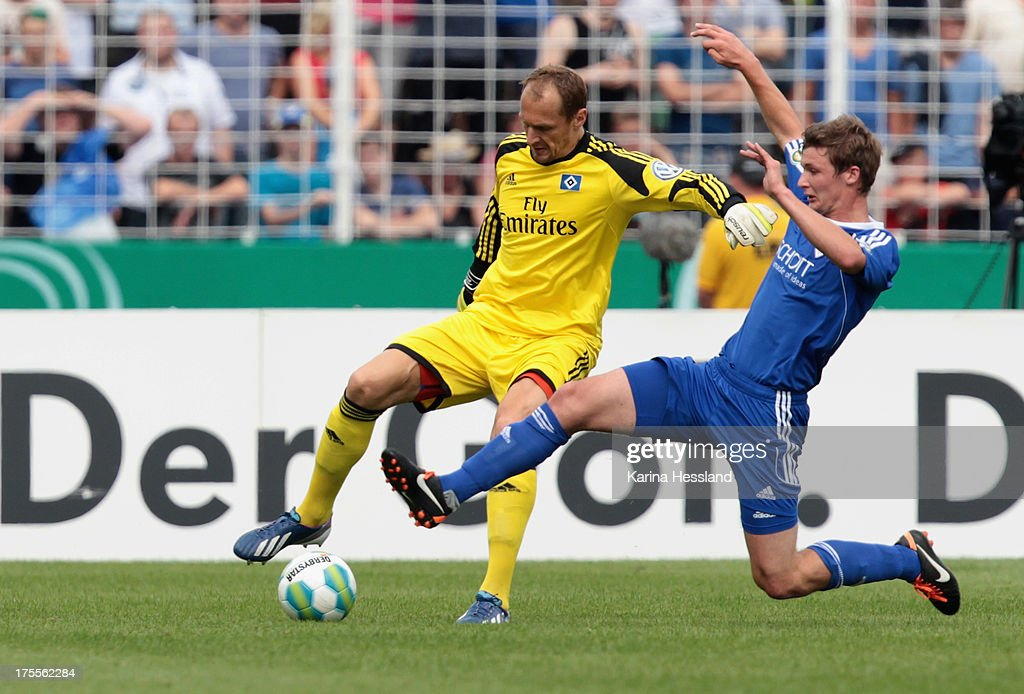 Benjamin Bahner of Jena challenges Goalkeeper <a gi-track='captionPersonalityLinkClicked' href=/galleries/search?phrase=Jaroslav+Drobny&family=editorial&specificpeople=1569062 ng-click='$event.stopPropagation()'>Jaroslav Drobny</a> of Hamburg during the DFB Cup between SV Schott Jena and Hamburger SV at Ernst-Abbe-Sportfeld on August 04, 2013 in Jena,Germany.