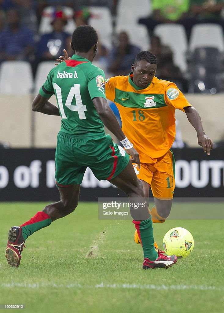 AFRICA - JANUARY 29, Benjamin Balima from Burkina Faso (L) and Emmanuel Mbola from Zambia in action during the 2013 Orange African Cup of Nations match between Burkina Faso and Zambia from Mbombela Stadium on January 29, 2013 in Nelspruit, South Africa.