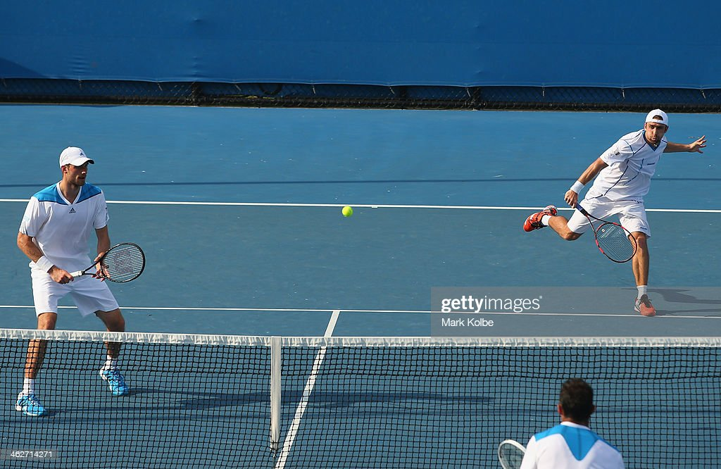 Benjamin Becker of Germany and Daniel Brands of Germany in action in their first round doubles match against Daniel Nestor of Canada and Nenad...