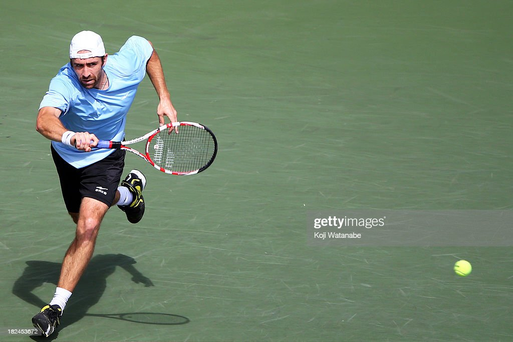 Benjamin Becker of Germany in action during his men's first round match against Nicolas Almagro of Spain during day one of the Rakuten Open at Ariake Colosseum on September 30, 2013 in Tokyo, Japan.
