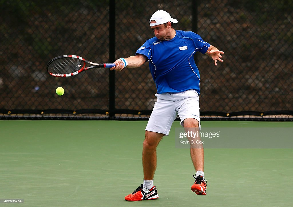 Benjamin Becker of Germany returns a forehand to Matthew Ebden of Australia during the BB&T Atlanta Open at Atlantic Station on July 22, 2014 in Atlanta, Georgia.