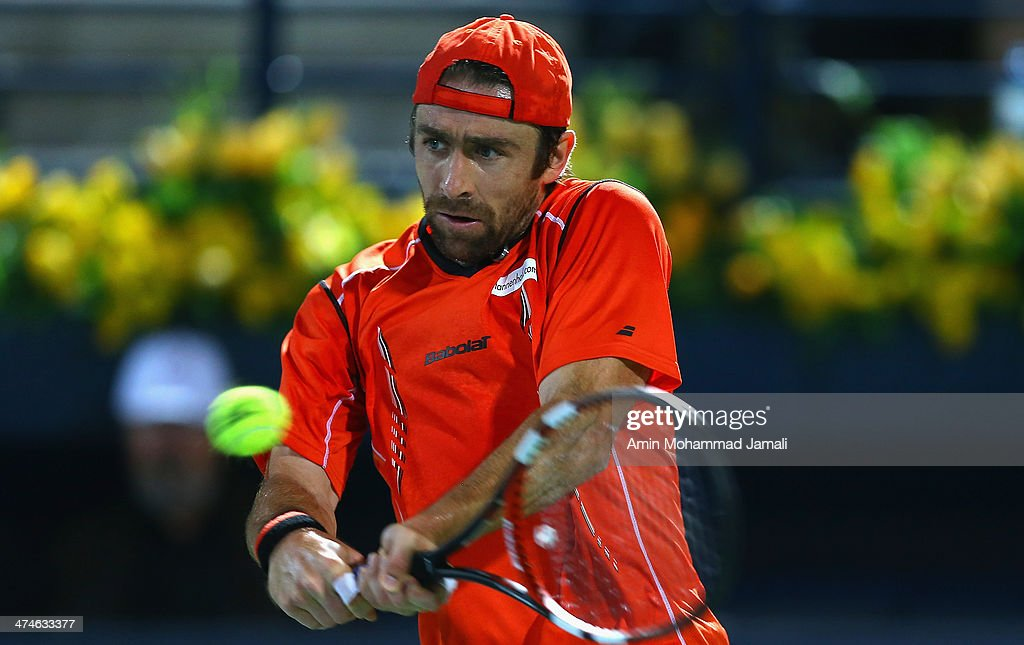 <a gi-track='captionPersonalityLinkClicked' href=/galleries/search?phrase=Benjamin+Becker&family=editorial&specificpeople=777311 ng-click='$event.stopPropagation()'>Benjamin Becker</a> of Germany returns the ball to <a gi-track='captionPersonalityLinkClicked' href=/galleries/search?phrase=Roger+Federer&family=editorial&specificpeople=157480 ng-click='$event.stopPropagation()'>Roger Federer</a> of Switzerland during their first round match of the Dubai Duty Free Tennis ATP Championships in Dubai on February 24, 2014 in Dubai, United Arab Emirates.