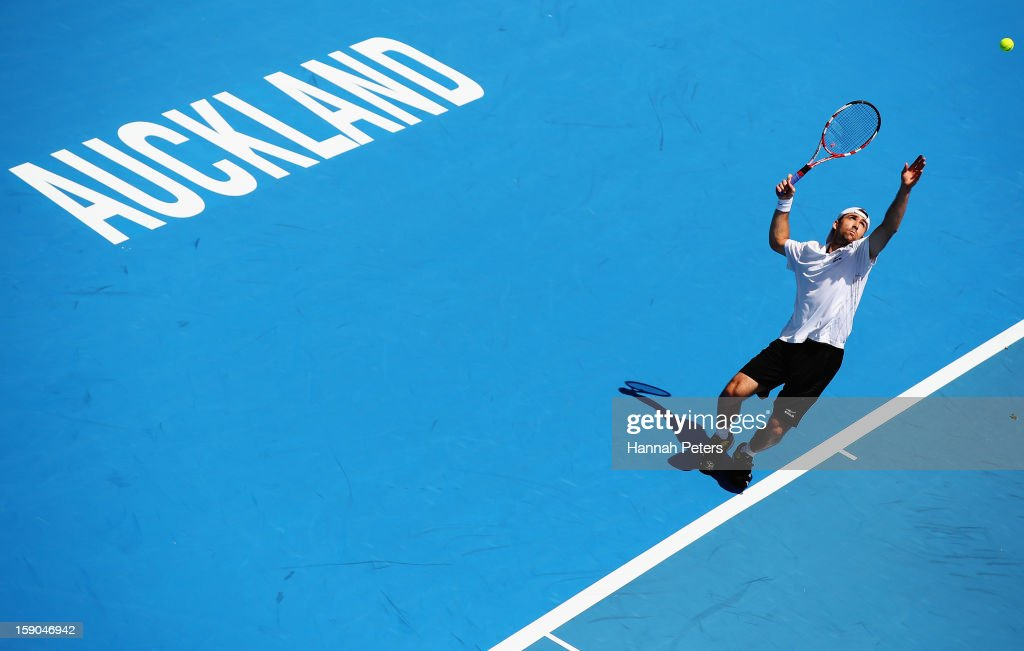 <a gi-track='captionPersonalityLinkClicked' href=/galleries/search?phrase=Benjamin+Becker&family=editorial&specificpeople=777311 ng-click='$event.stopPropagation()'>Benjamin Becker</a> of Germany serves in his first round match against Lukas Rosol of Czechoslovakia during day one of the Heineken Open at ASB Tennis Centre on January 7, 2013 in Auckland, New Zealand.