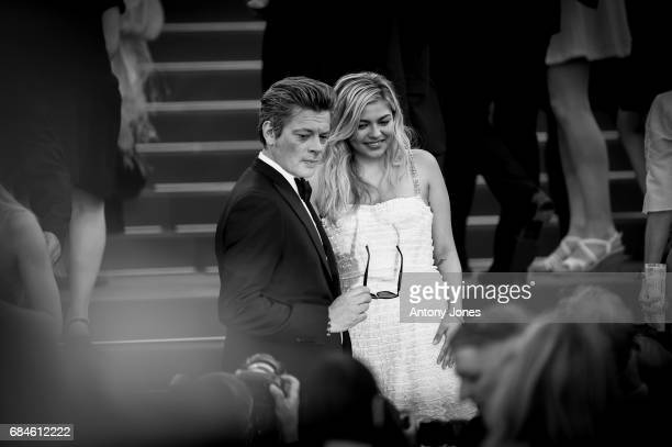 Benjamin Biolay and Louane Emera attend the 'Ismael's Ghosts ' Opening Gala Red Carpet Arrivals during the 70th annual Cannes Film Festival at on May...