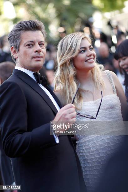 Benjamin Biolay and singer Louane Emera attend the 'Ismael's Ghosts ' screening and Opening Gala during the 70th annual Cannes Film Festival at...