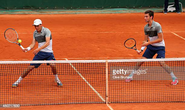 Benjamin Bonzi and Quentin Halys of France in action during the boys' doubles final match against Akira Santillan of Australia and Lucas Miedler of...