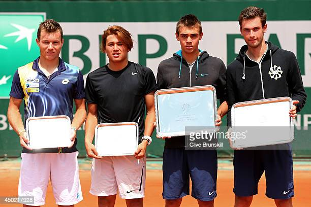 Benjamin Bonzi and Quentin Halys of France pose next to Akira Santillan of Australia and Lucas Miedler of Austria with their trophies following their...