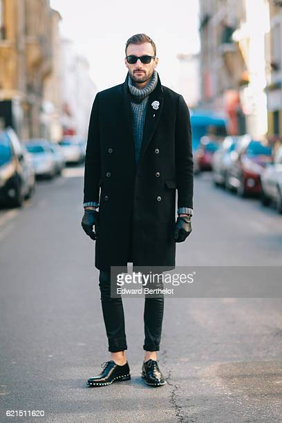 Benjamin Boulay is wearing an HM black long coat a Zadig Voltaire gray turtleneck pull over The Kooples black denim jeans Givenchy black shoes and...