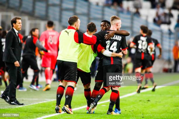 Benjamin Bourigeaud and Faitout Maouassa of Rennes celebrate his goal during the Ligue 1 match between Olympique Marseille and Stade Rennais at Stade...
