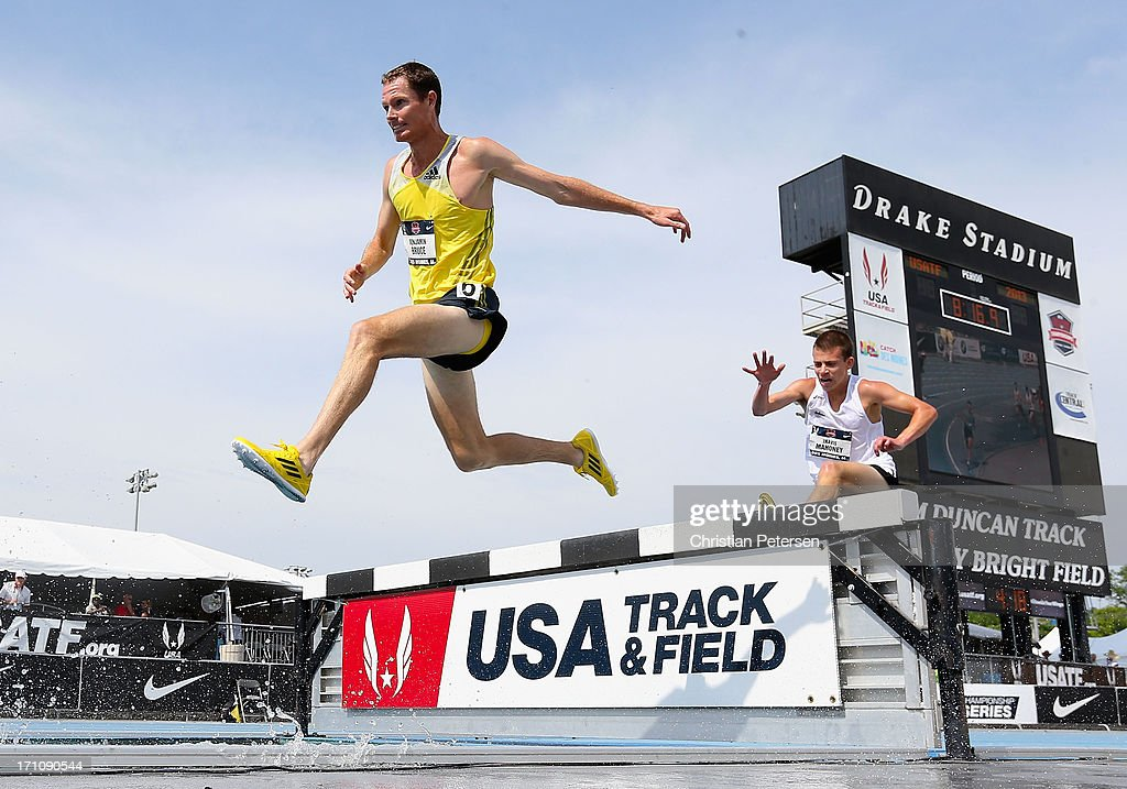 Benjamin Bruce and Travis Mahoney compete in the Men's 3000 Meter Steeplechase on day two of the 2013 USA Outdoor Track & Field Championships at Drake Stadium on June 21, 2013 in Des Moines, Iowa.