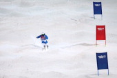 Benjamin Cavet of France competes in the Men's Moguls Finals on day three of the Sochi 2014 Winter Olympics at Rosa Khutor Extreme Park on February...