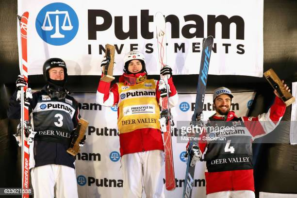Benjamin Cavet of France Mikael Kingsbury of Canada and Philippe Marquis of Canada celebrate on the medals podium after the Men's Moguls during the...