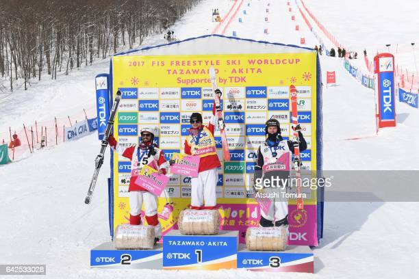 Benjamin Cavet of France Mikael Kingsbury of Canada Philippe Marquis of Canada celebrate after winning the men's moguls during 2017 FIS Freestyle Ski...
