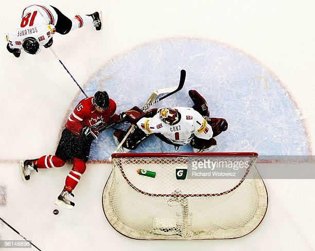 Benjamin Conz of Team Switzerland stops the puck on an attempt by Brandon McMillan of Team Canada during the 2010 IIHF World Junior Championship...