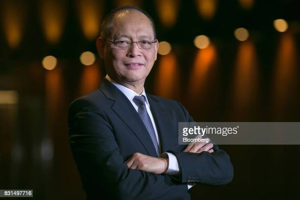 Benjamin Diokno the Philippines' budget secretary stands for a photograph following a Bloomberg Television interview in Singapore on Tuesday Aug 15...