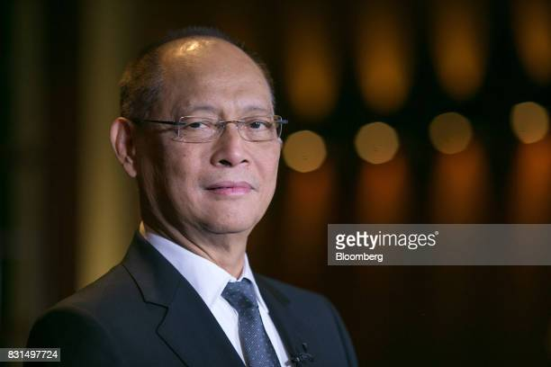 Benjamin Diokno the Philippines' budget secretary stands for a photograph before a Bloomberg Television interview in Singapore on Tuesday Aug 15 2017...
