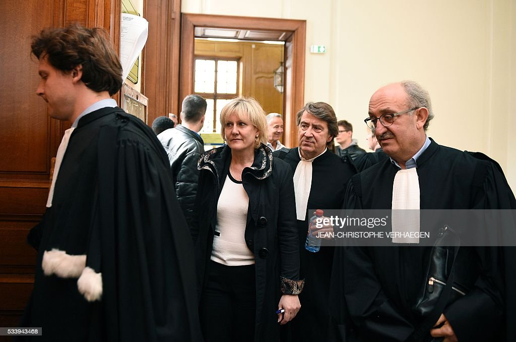 Benjamin Domange(L), lawyer of Guy Bedos, and French member of the European Parliament Nadine Morano (2nd L) , flanked by her lawyers Alain Behr (2nd R) and Antoine Fittante (R), arrive at the courthouse of Nancy for the trial in an appeal process of French humorist Guy Bedos in a libel suit on May 24, 2016. Bedos called Morano a 'bitch' during a show in Toul, northeastern France in 2013. / AFP / JEAN